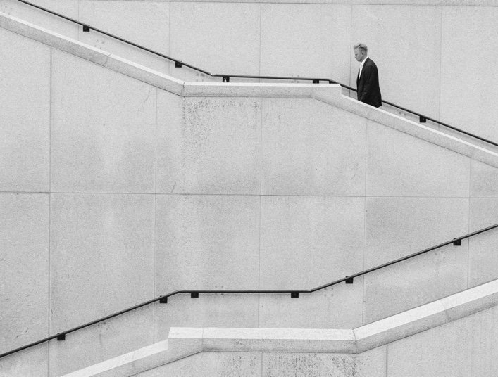 business owner walking up stairs black and white